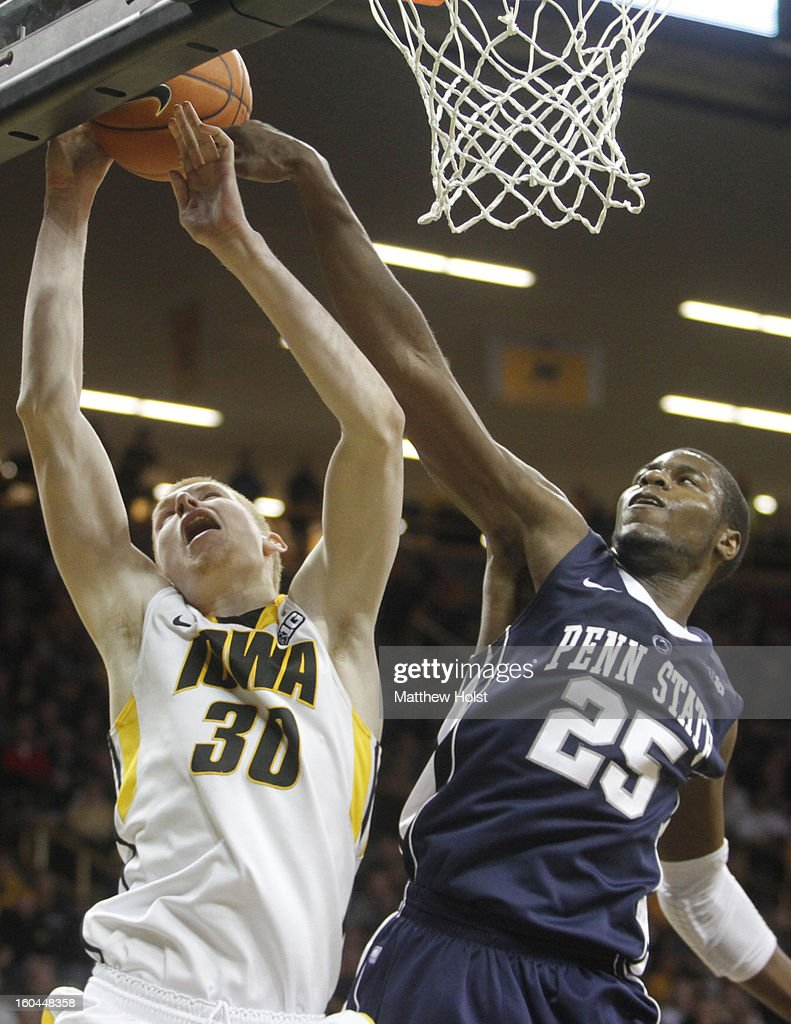 Forward Aaron White #30 of the Iowa Hawkeyes goes to the basket during the second half in front of forward Jon Graham #25 of the Penn State Nittany Lions on January 31, 2013 at Carver-Hawkeye Arena in Iowa City, Iowa.