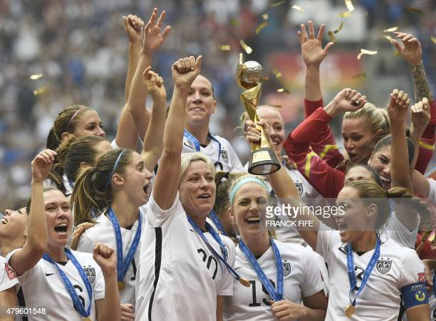 USA forward Abby Wambach and teammates celebrate after their victory in the final football match between USA and Japan during their 2015 FIFA Women's...