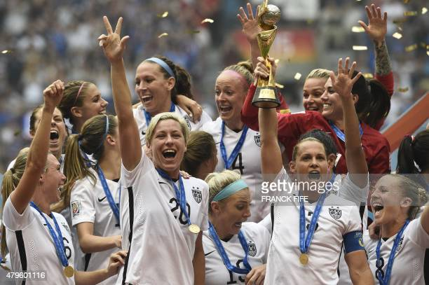 USA forward Abby Wambach and teammates their victory in the final football match between USA and Japan during the 2015 FIFA Women's World Cup at the...