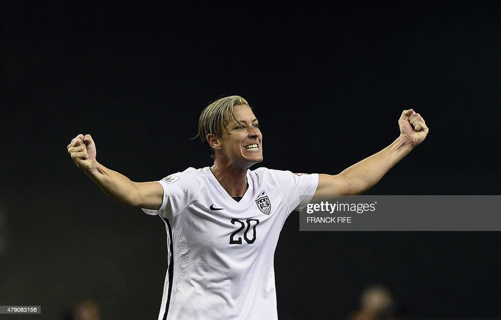USA forward Abby Wambach celebrates after winning the semifinal football match between USA and Germany during their 2015 FIFA Women's World Cup at...