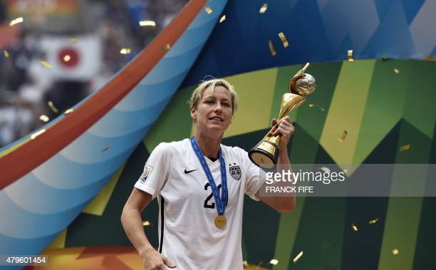 USA forward Abby Wambach holds The World Cup as he celebrates the 52 victory in the final football match between USA and Japan during their 2015 FIFA...