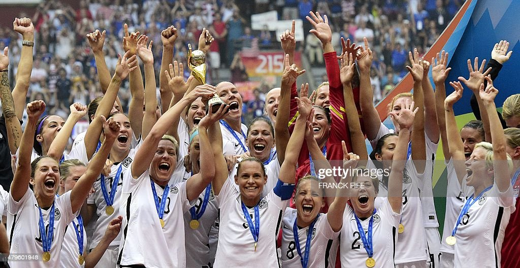 USA forward Abby Wambach holds The World Cup as she celebrates with teammates after their victory in the final football match between USA and Japan...