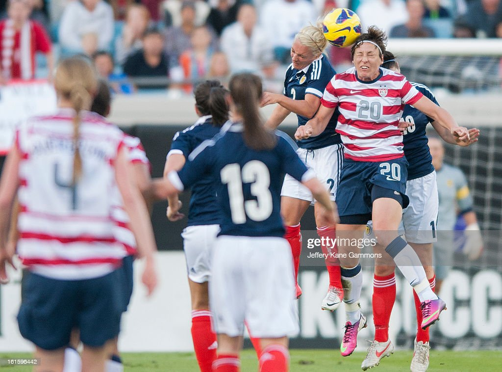 Forward Abby Wambach #20 of the United States and Defender Rhonda Jones #2 of Scotland head the ball during the game at EverBank Field on February 9, 2013 in Jacksonville, Florida.