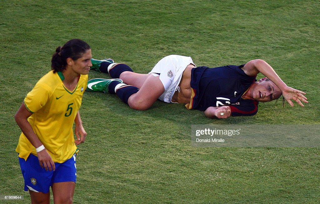 Forward Abby Wambach of the United States signals for the team doctors after sustaining a injury to her leg during the International Friendly Match...