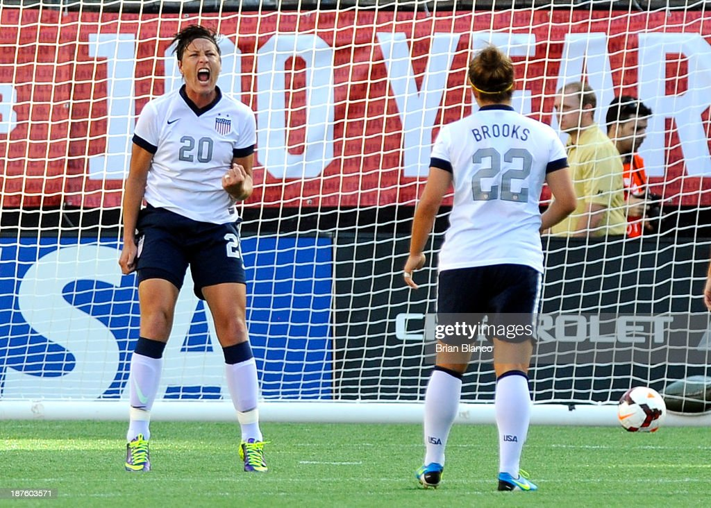 Forward Abby Wambach of the US Women's National Team celebrates with midfielder Amber Brooks after scoring on a penalty kick against Brazil on...