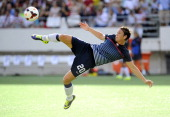 Forward Abby Wambach of the US Women's National Team takes a shot on goal while warming up before the start of their game against Brazil on November...