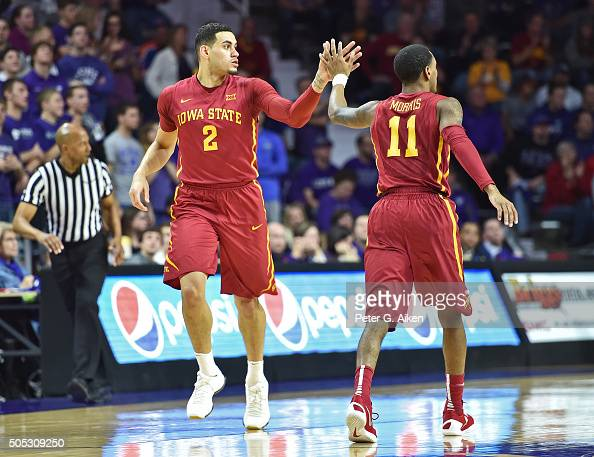 Forward Abdel Nader of the Iowa State Cyclones gets a hand from teammate Monte Morris after scoring on a threepoint shot against the Kansas State...