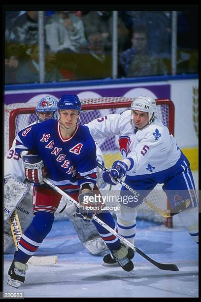 Forward Adam Graves of the New York Rangers works against the Quebec Nordiques during a game at Quebec Coliseum in Quebec City Quebec Mandatory...