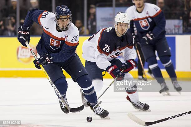 Forward Adam Ruzicka of Team Slovakia skates through the neutral zone as Forward Jack Roslovic of Team United States chases in a preliminary round...
