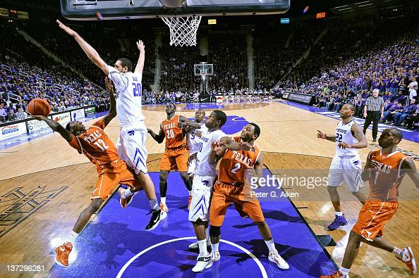 Forward Adrian Diaz of the Kansas State Wildcats defends against guard Myck Kabongo of the Texas Longhorns during the second half on January 18 2012...