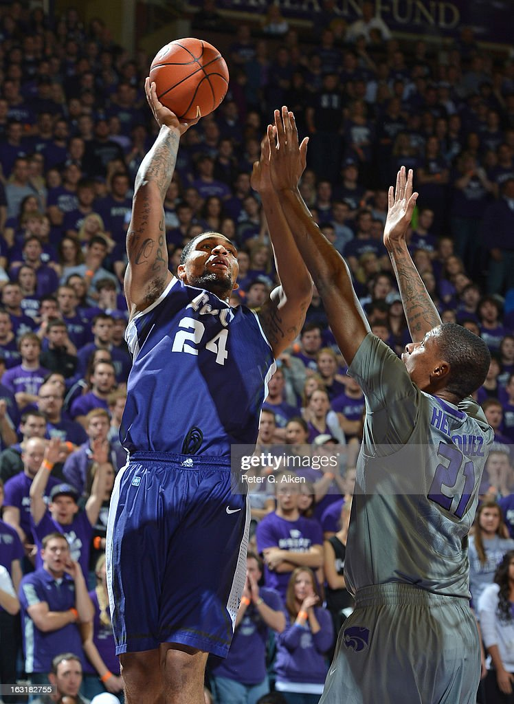 Forward Adrick McKinney #24 of the Texas Christian Horned Frogs puts up a shot over forward Jordan Henriquez #21 of the Kansas State Wildcats during the first half on March 5, 2013 at Bramlage Coliseum in Manhattan, Kansas. Kansas State defeated Texas Christian 79-68.
