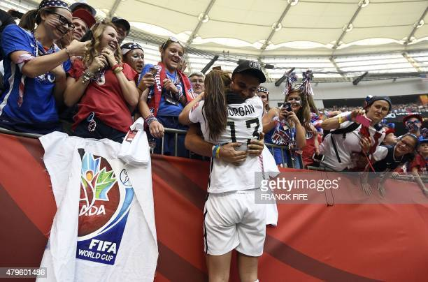 USA forward Alex Morgan is congratulated after the victory in the final football match between USA and Japan during their 2015 FIFA Women's World Cup...
