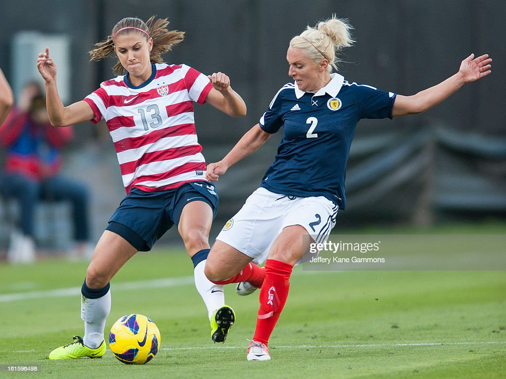 Forward Alex Morgan #13 of the United States and Defender Rhonda Jones #2 of Scotland fight over the ball during the game at EverBank Field on February 9, 2013 in Jacksonville, Florida.