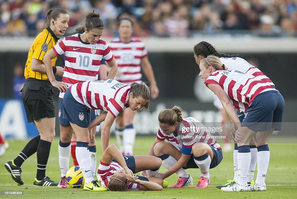 Forward Alex Morgan #13 of the United States lies on the ground after being injured on a play during the game against Scotland at EverBank Field on February 9, 2013 in Jacksonville, Florida.