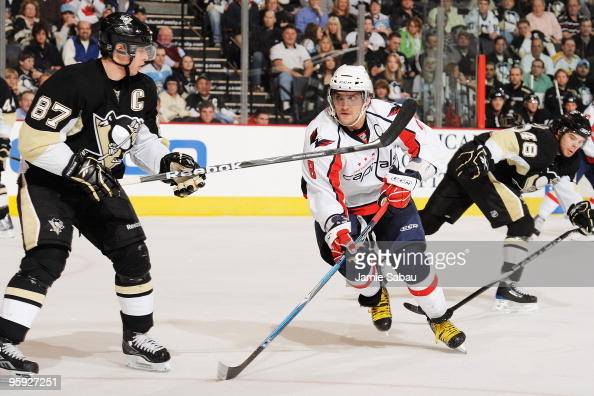 Forward Alex Ovechkin of the Washington Capitals lines up forward Sidney Crosby of the Pittsburgh Penguins for a check on January 21 2010 at Mellon...