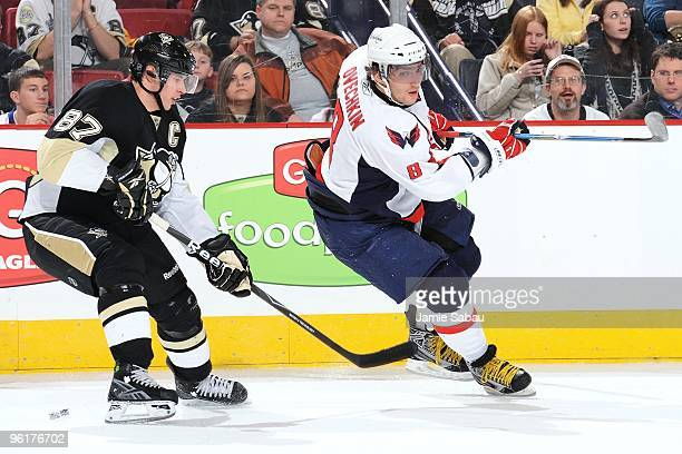 Forward Alex Ovechkin of the Washington Capitals skates as forward Sidney Crosby of the Pittsburgh Penguins defends on January 21 2010 at Mellon...