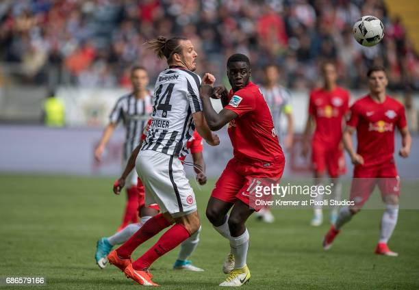 Forward Alexander Meier of Eintracht Frankfurt and Defense Dayot Upamecano of RB Leipzig fighting for the ball at the Commerzbank Arena during the 1...