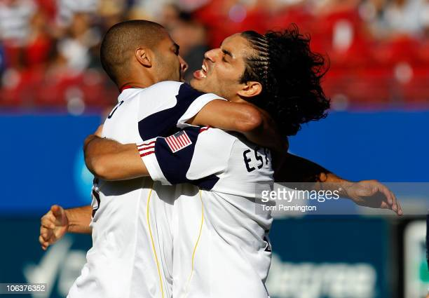 Forward Alvaro Saborio of Real Salt Lake celebrates with forward Fabian Espindola of Real Salt Lake after Espindola scored against FC Dallas at Pizza...