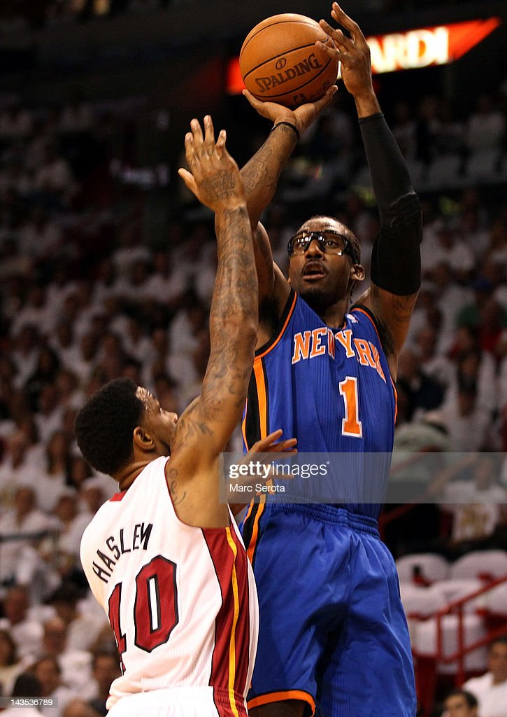 Forward <a gi-track='captionPersonalityLinkClicked' href=/galleries/search?phrase=Amar%27e+Stoudemire&family=editorial&specificpeople=201492 ng-click='$event.stopPropagation()'>Amar'e Stoudemire</a> #1 (R) of the New York Knicks shoots over Forward <a gi-track='captionPersonalityLinkClicked' href=/galleries/search?phrase=Udonis+Haslem&family=editorial&specificpeople=201748 ng-click='$event.stopPropagation()'>Udonis Haslem</a> #40 of the Miami Heat in Game One of the Eastern Conference Quarterfinals in the 2012 NBA Playoffs on April 28, 2012 at the American Airines Arena in Miami, Florida. The Heat defeated the Knicks 100-67.