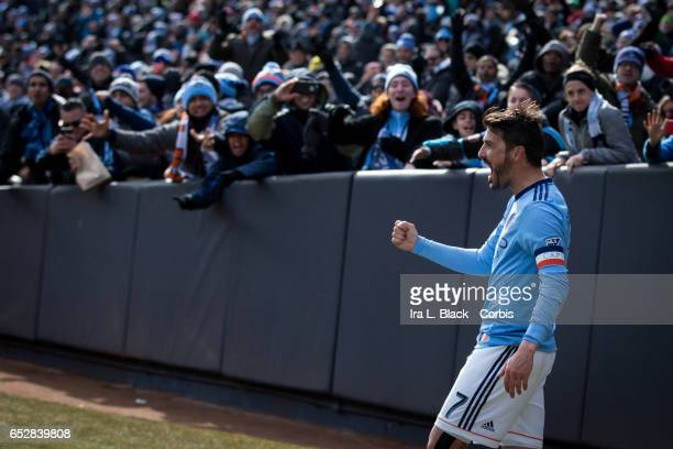 Forward and Captain David Villa of New York City FC celebrates his 2nd goal of the match with the fans cheering in the background during the 2017 MLS...