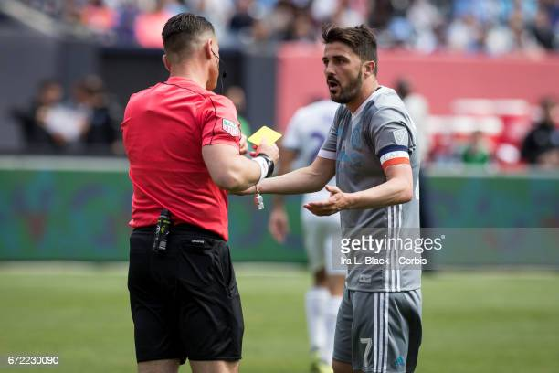 Forward and Captain David Villa of New York City FC gets a yellow card during the MLS match between New York City FC vs Orlando City SC on April 23...
