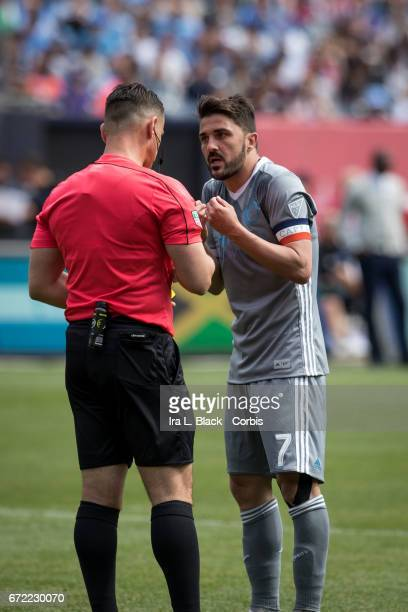 Forward and Captain David Villa of New York City FC has a discussion with the referee about his yellow card during the MLS match between New York...