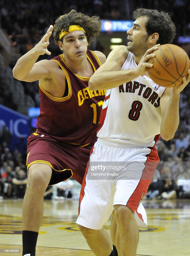 Forward <a gi-track='captionPersonalityLinkClicked' href=/galleries/search?phrase=Anderson+Varejao&family=editorial&specificpeople=202247 ng-click='$event.stopPropagation()'>Anderson Varejao</a> #17 of the Cleveland Cavaliers looks to stop the pass of guard Jose Calderon #8 of the Toronto Raptors during a game with the Toronto Raptors at Quicken Loans Arena in Cleveland, Ohio. The Raptors won 104 – 96.