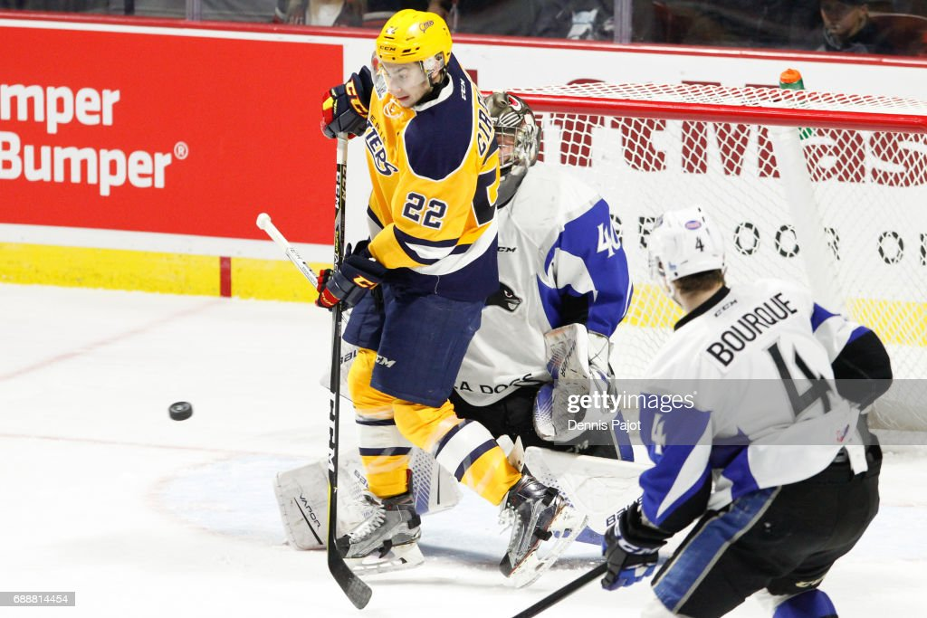 Forward Anthony Cirelli #22 of the Erie Otters deflects the puck against goaltender Callum Booth #40 of the Saint John Sea Dogs on May 26, 2017 during the semifinal game of the Mastercard Memorial Cup at the WFCU Centre in Windsor, Ontario, Canada.