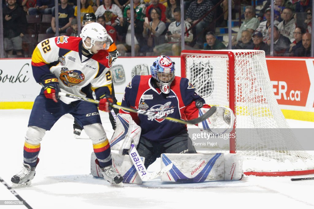 Forward Anthony Cirelli #22 of the Erie Otters deflects the puck against goaltender Michael DiPietro #64 of the Windsor Spitfires on May 28, 2017 during the championship game of the Mastercard Memorial Cup at the WFCU Centre in Windsor, Ontario, Canada.