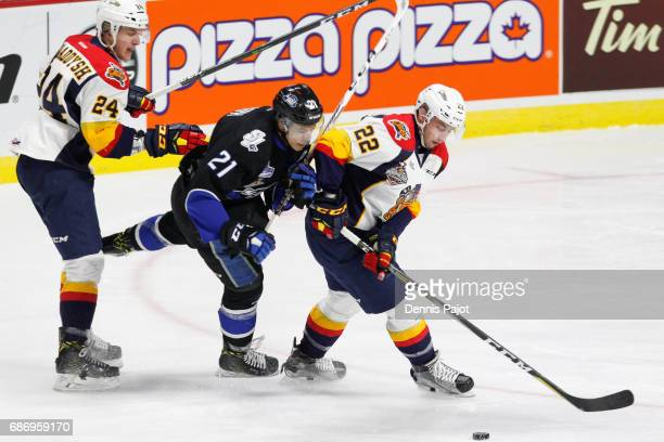 Forward Anthony Cirelli of the Erie Otters moves the puck against forward against Mathieu Joseph of the Saint John Sea Dogs on May 22 2017 during...