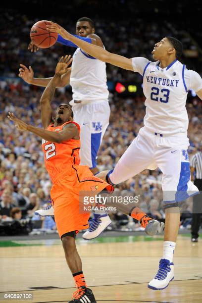 Forward Anthony Davis and teammate forward Terrence Jones from the University of Kentucky block a shot attempt from guard Russ Smith from the...