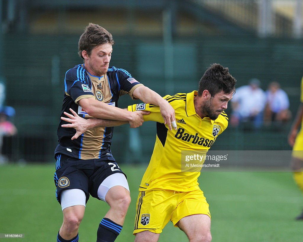 Forward Antoine Hoppenot #29 of the Philadelphia Union battles midfielder Danny O'Rourke #5 of the Columbus Crew February 13, 2013 in the second round of the Disney Pro Soccer Classic in Orlando, Florida.