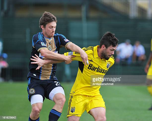 Forward Antoine Hoppenot of the Philadelphia Union battles midfielder Danny O'Rourke of the Columbus Crew February 13 2013 in the second round of the...
