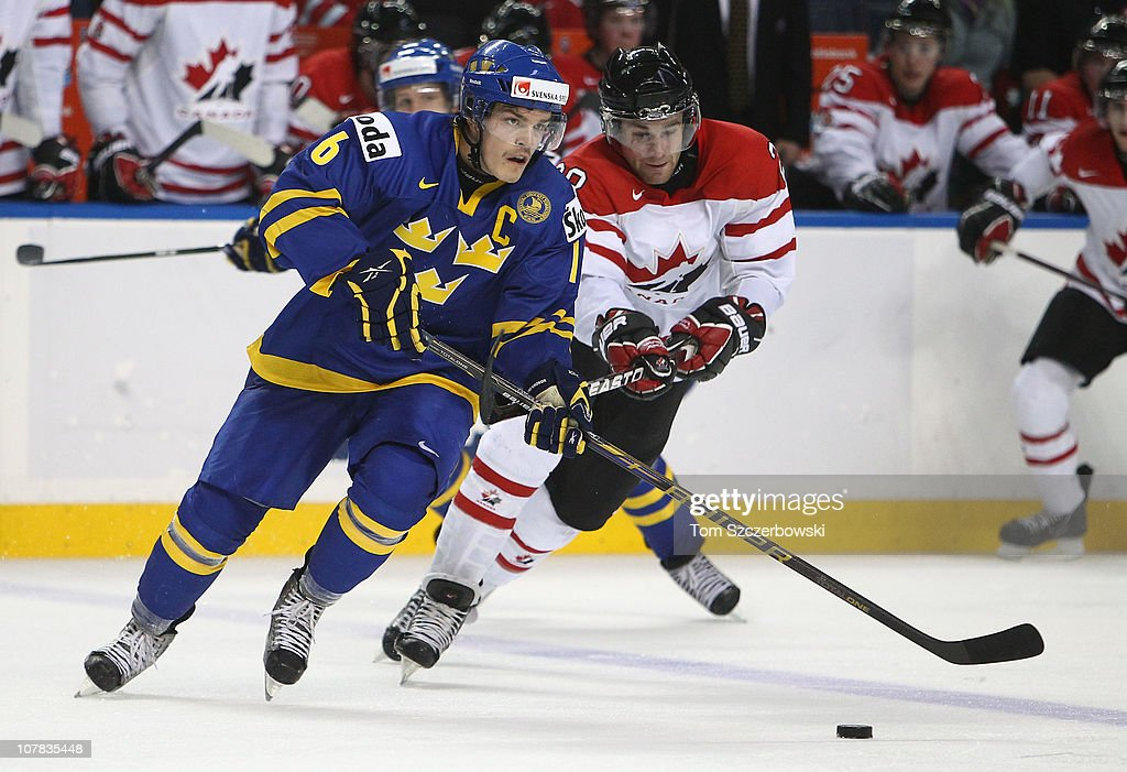 Forward Anton Lander #16 of Sweden skates away from forward <a gi-track='captionPersonalityLinkClicked' href=/galleries/search?phrase=Brett+Connolly&family=editorial&specificpeople=5870564 ng-click='$event.stopPropagation()'>Brett Connolly</a> #28 of Canada during the 2011 IIHF World U20 Championship game between Canada and Sweden on December 31, 2010 at HSBC Arena in Buffalo, New York.