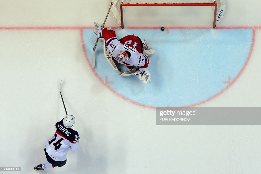 US forward Auston Matthews scores the game-winning penalty shot past Czech goalie Dominik Furch during the quarterfinal game Czech Republic vs USA at the 2016 IIHF Ice Hockey World Championship in Moscow on May 19, 2016.KADOBNOV