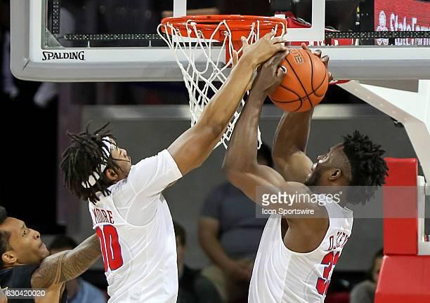 SMU forward Ben Moore and forward Semi Ojeleye go for a rebound during the NCAA men's basketball game between SMU Mustangs and UC Santa Barbara...