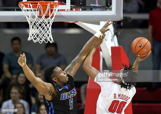 SMU forward Ben Moore tries to get a shot over UC Santa Barbara forward Jalen Canty during the NCAA men's basketball game between SMU Mustangs and UC...