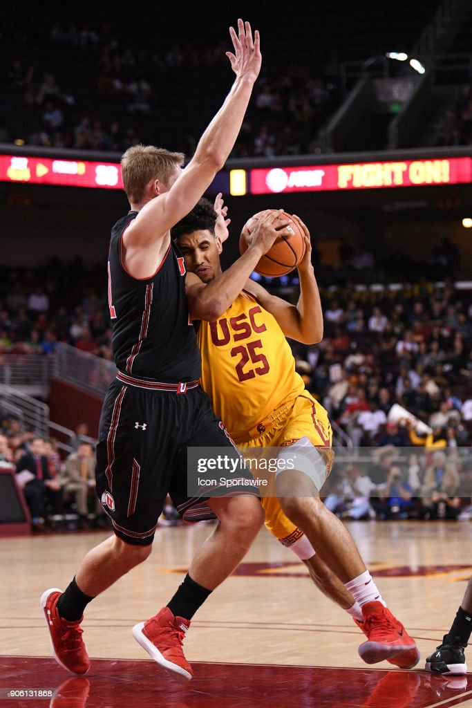 USC forward Bennie Boatwright (25) drives right into Utah forward Tyler Rawson (21) during a college basketball game between the Utah Utes and the USC Trojans on January 14, 2018, at the Galen Center in Los Angeles, CA.