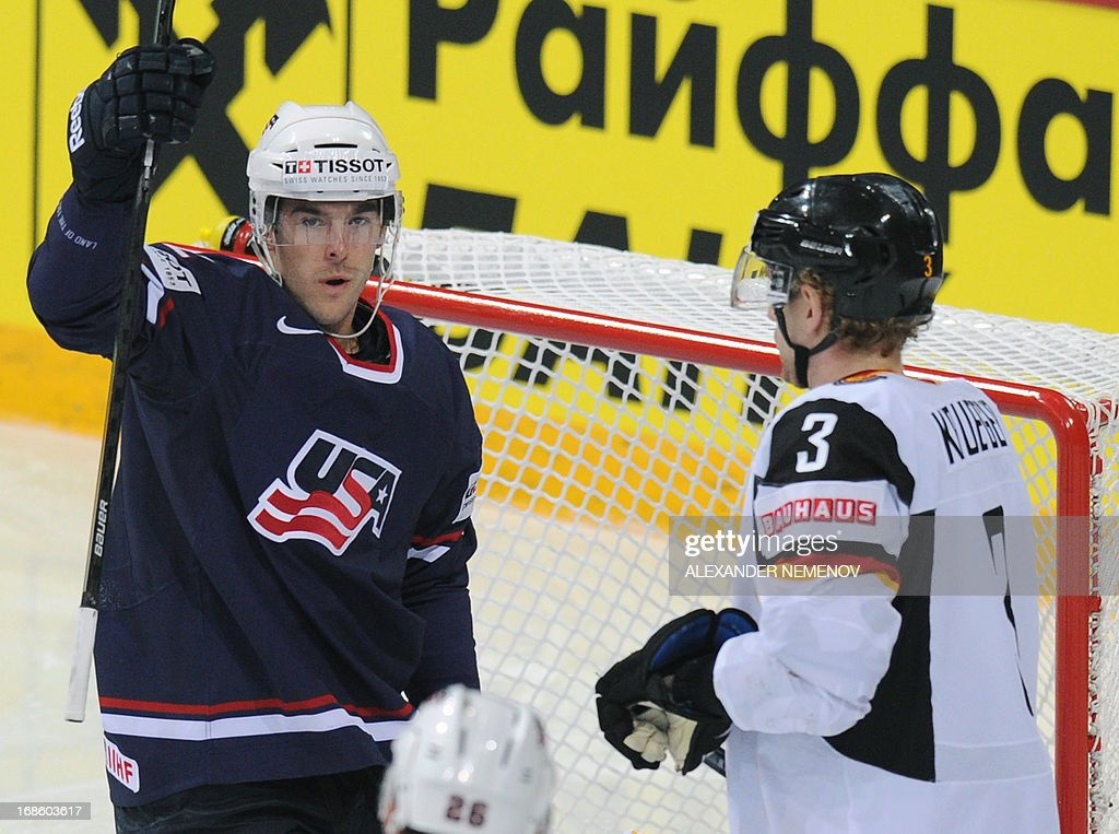 US forward Bobby Butler celebrate scoring next to Germany's defender Justin Krueger during the preliminary round match Germany vs USA at the IIHF...