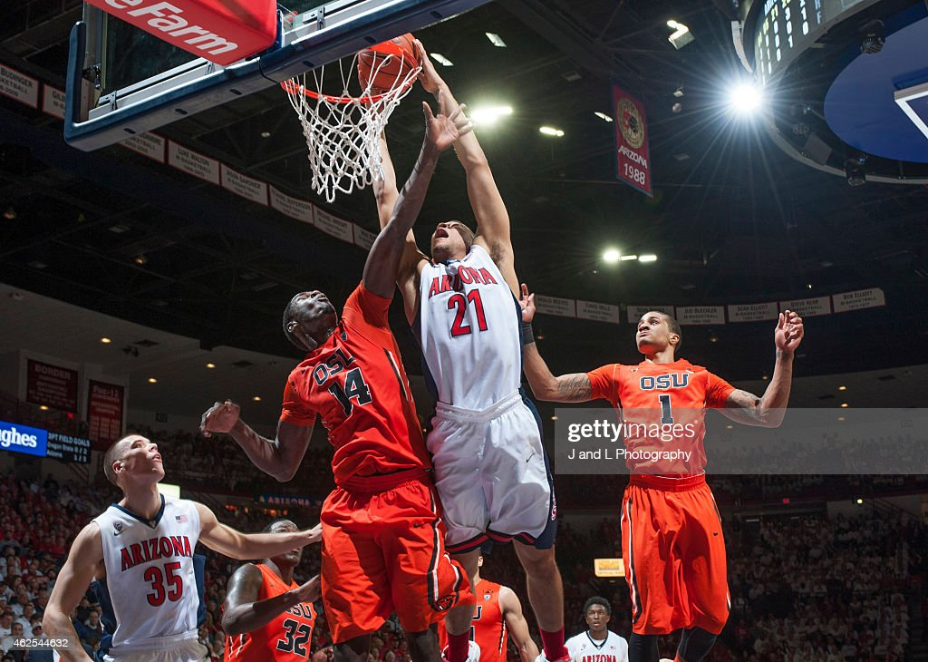 Forward Brandon Ashley of the Arizona Wildcats shoots over forawrd Daniel Gomis of the Oregon State Beavers at McKale Center on January 30 2015 in...