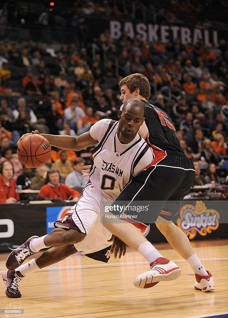 Forward Bryan Davis #0 of the Texas A&M Aggies moves the ball past Robert Lewandowski #15 of the Texas Tech Red Raiders during the Phillips 66 Big 12 Men's Basketball Championship at the Ford Center March 11, 2009 in Oklahoma City, Oklahoma.
