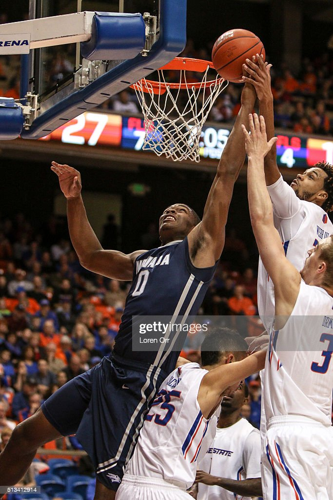 Forward Cameron Oliver of the Nevada Wolf Pack attempts to grab a rebound from forward James Webb III of the Boise State Broncos during first half...