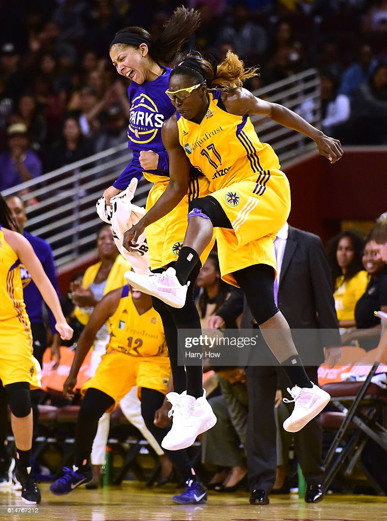 Forward Candace Parker #3 and forward Essence Carson #17 of the Los Angeles Sparks celebrate a three pointer after a timeout enroute to a 92-75 Sparks win in game three of the 2016 WNBA Finals at Galen Center on October 14, 2016 in Los Angeles, California.