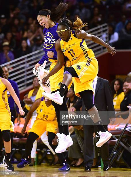 Forward Candace Parker and forward Essence Carson of the Los Angeles Sparks celebrate a three pointer after a timeout enroute to a 9275 Sparks win in...
