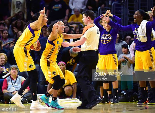 Forward Candace Parker and guard Kristi Toliver of the Los Angeles Sparks argue a foul call with referee Roy Gulbeyan during an 8579 loss to the...