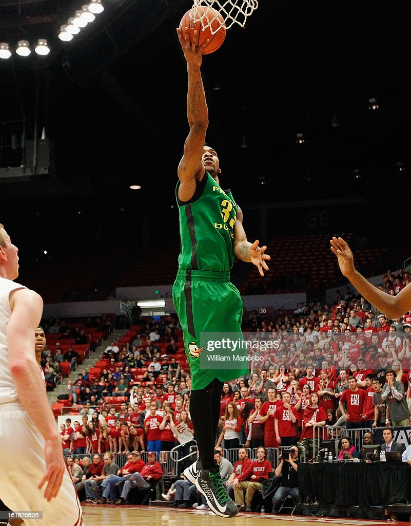 Forward Carlos Emory #33 of the Oregon Ducks goes to the basket during the game against the Washington State Cougars at Beasley Coliseum on February 16, 2013 in Pullman, Washington.