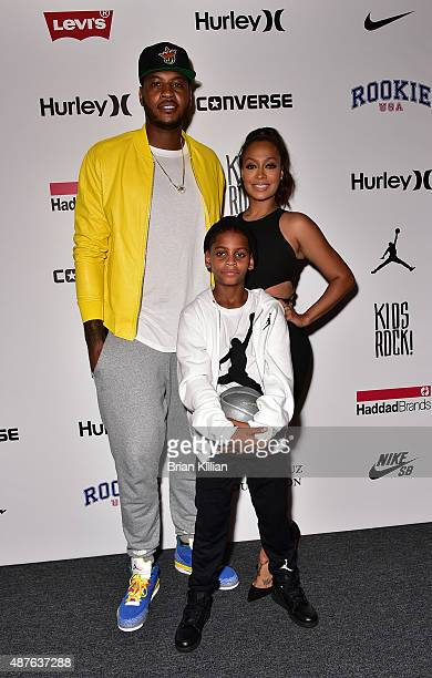 NBA forward Carmelo Anthony his wife La La Anthony and son Kiyan Anthony attend the Kids Rock show during New York Fashion Week at The Dock Skylight...
