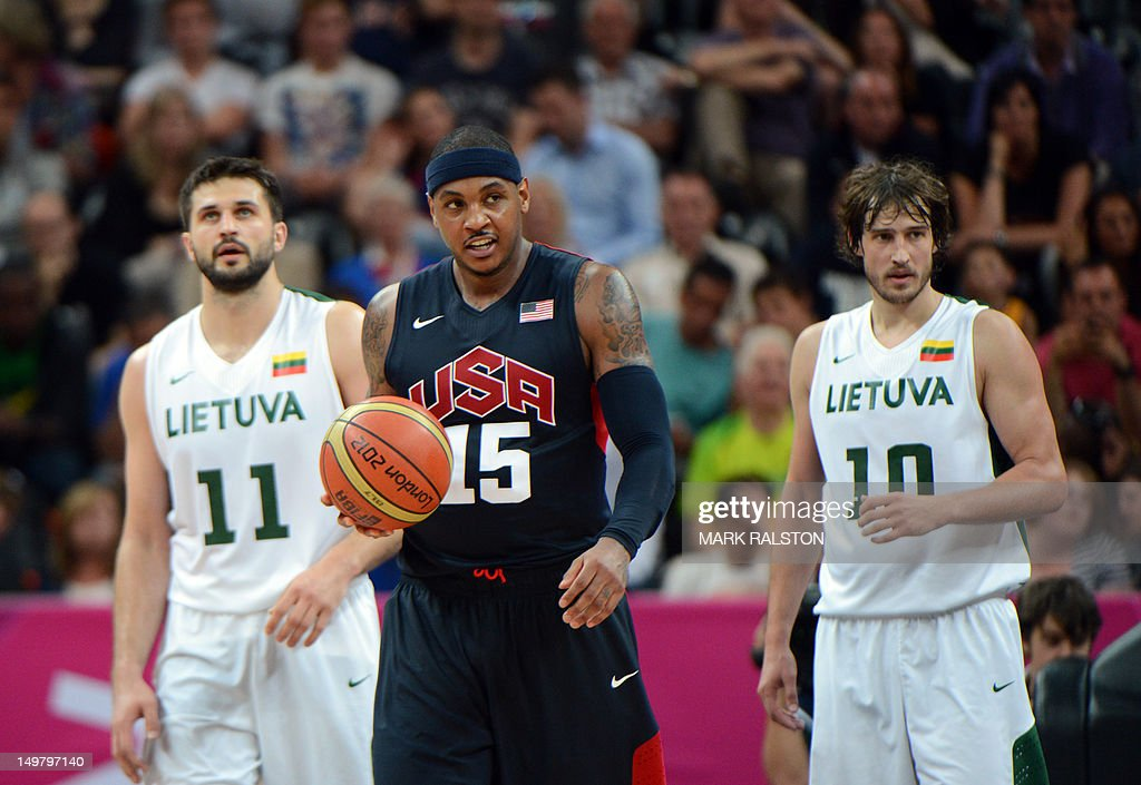 US forward Carmelo Anthony (C) Lithuanian forward Simas Jasaitis (R) and forward Linas Kleiza (L) are pictured during their London 2012 Olympic Games men's preliminary round group A basketball match in London on August 4, 2012. US won 99-94. AFP PHOTO / MARK RALSTON
