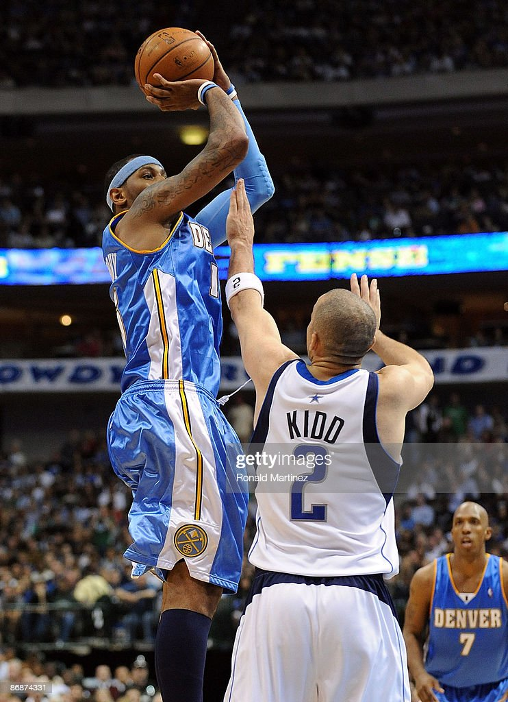 Forward <a gi-track='captionPersonalityLinkClicked' href=/galleries/search?phrase=Carmelo+Anthony&family=editorial&specificpeople=201494 ng-click='$event.stopPropagation()'>Carmelo Anthony</a> #15 of the Denver Nuggets takes a shot against Jason Kidd #2 of the Dallas Mavericks in Game Three of the Western Conference Semifinals during the 2009 NBA Playoffs at American Airlines Center on May 9, 2009 in Dallas, Texas.