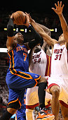 Forward Carmelo Anthony of the New York Knicks is defended by Forward Joel Anthony and Shanes Battier of the Miami Heat in Game One of the Eastern...